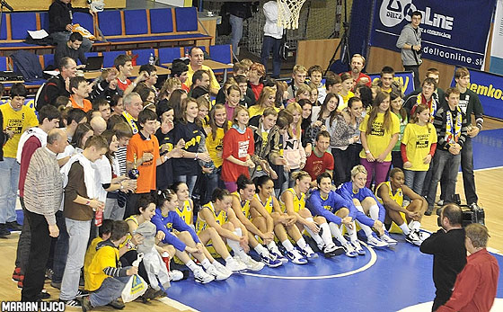 "Good Angels' players pose with the young participants of the campaign ""Zober loptu, nie drogy""   (""Take a ball, no drugs"") which the Kosice club supports"