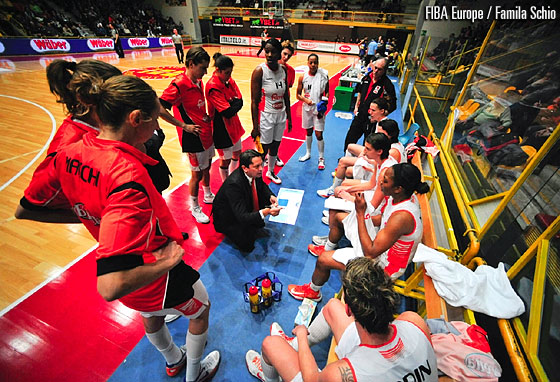 Famila Schio head coach Maurizio Lasi addresses his players during a time-out