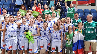 The Slovenia team celebrate with their fans