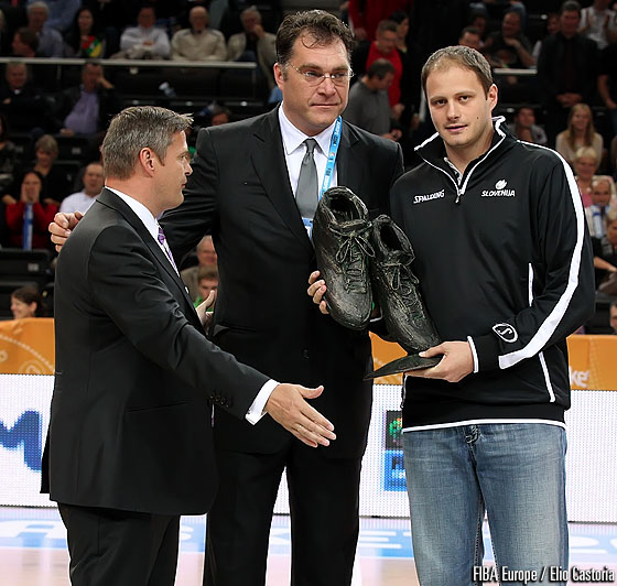 FIBA Europe President Olafur Rafnsson presents the handing over of the big shoes to fill from EuroBasket 2011 Ambassador Arvydas Sabonis to Eurobasket 2013 Ambassador Rasho Nesterovic
