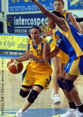 Parma's Anna Costalunga drives to the basket defended by Gdynia's Chasity Melvin