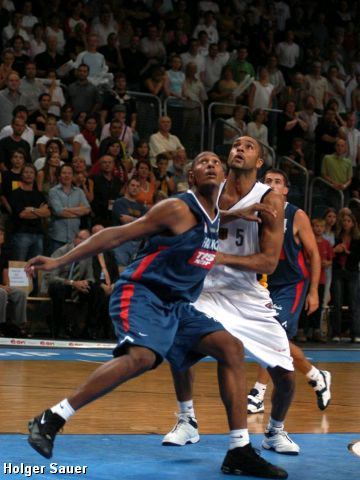 Germany's Ademola Okulaja and France's Boris Diaw battle under the boards during their match-up at the Super Cup in Bamberg