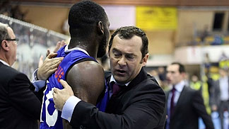 Paris head coach Christoph Denis and Giovan Oniangue hug after their vital win over Szolnoki Olaj