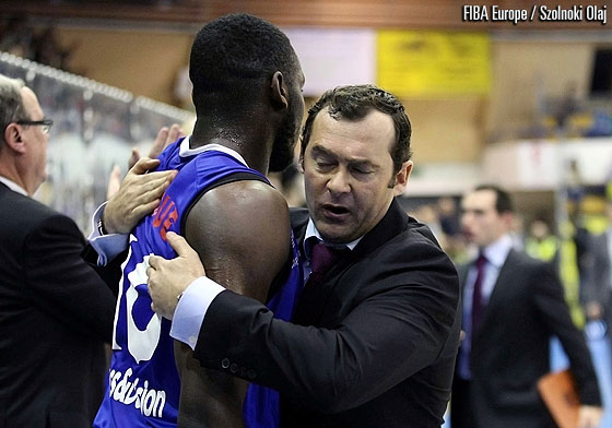 Paris' head coach Christoph Denis and Giovan Oniangue hug after their vital win over Szolnoki Olaj