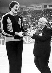 TT Riga center Uljana Semjonova is presented with the 1969 European Cup for Womens Champions clubs trophy by former FIBA President Robert Busnel. Riga defeated German side SC Chemie for the title, their 6th in a row.