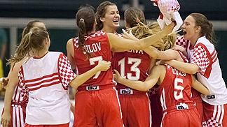 Croatia celebrate their Second Round win over Latvia