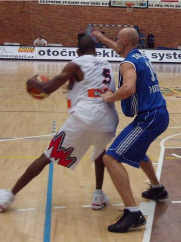 Nymburk's Ashante Johnson goes to work in the low post against Dynamo's Dmitri Domani