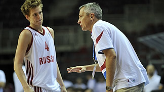Head coach Alexandr Afanasyev gives advice to Alexander Gavrilov