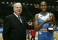 7. Sandrine Gruda (Europe) receives the Womens Player of the Year award from FIBA Europe president George Vassilakopoulos