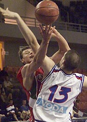 Dzmitry Paliashchuk (Belarus) guarded by Kosta Perovic (SCG)