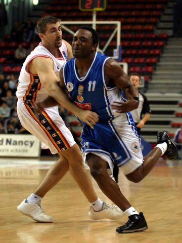 Spot the ball. Nahariya's Stevin Smith is fouled but the ball is nowhere to be seen
