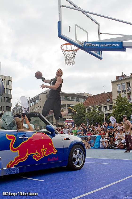 Vincent van Sliedregt taking part in the dunk contest in Antwerp. Although he completed a dunk over the hood of the car, Vincent finished just second in the competition