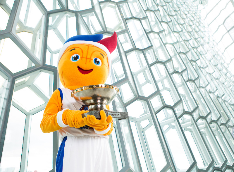 Mascot Frenkie with the EuroBasket trophy at the Harpa concert hall and conference centre in Reykjavík