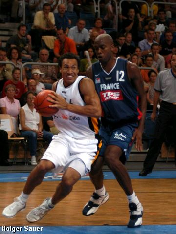 Germany's Robert Garret gets inside France's Thierry Rupert at the German Super Cup in Bamberg