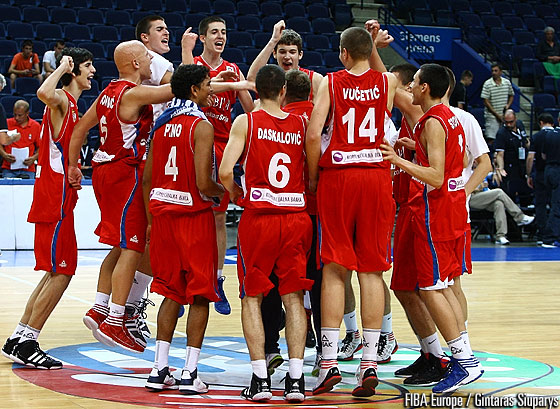 Serbia celebrate their triumph in the bronze medal game