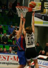 Ljubica Drljaca (Bourges) hits the contested lay up.