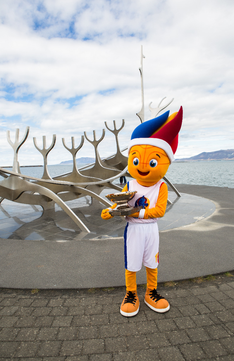 Mascot Frenkie with the EuroBasket trophy in front of the Sun Voyager in Reykjavik