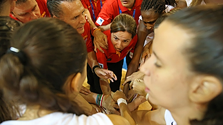 Spain Head Coach Anna Caula gives her troops last instructions prior to tip-off