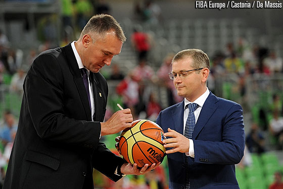 FIBA Europe Secretary General Kamil Novak putting his signature on the ball which is transferred between the Local Organising Committees of EuroBasket 2013 and 2015