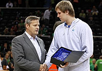 U18 All Star Game MVP Przemyslaw Karnowski receives the trophy from FIBA Europe President Olafur Rafnsson