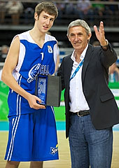 Slam dunk contest winner Sergey Karasev is presented the trophy by legendary coach Svetislav Pesic