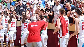 Hungary and their fans celebrate their opening victory over Sweden