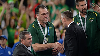 FIBA Europe Secretary General Kamil Novak giving the silver medal to Lithuanian Federation President Arvydas Sabonis