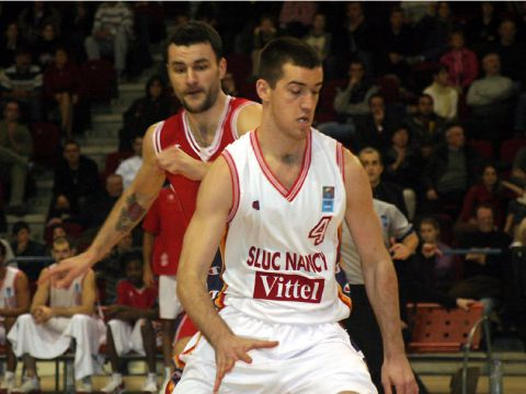 Nancy guard Nikola Dzeverdanovic dribbles while fellow countryman Milan Gurovic looks on
