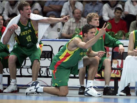 The Lithuania bench tries to encourage its players in the final against Russia