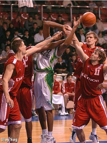 Tuborg's Aerick Sanders tries to grab a rebound in a crowd of Amsterdam players