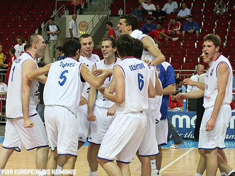 Serbia celebrate winning a spot in the gold medal game.