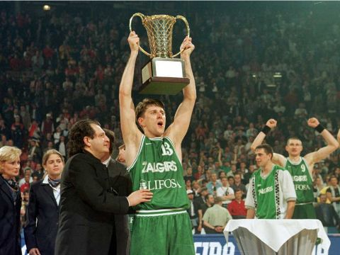 Zalgiris Kaunas' Darius Maskoliunas lifts the 1999 EuroLeague trophy