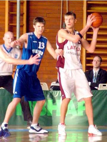 Latvia's Andris Biedrins posts up Finland's Antti Virta
