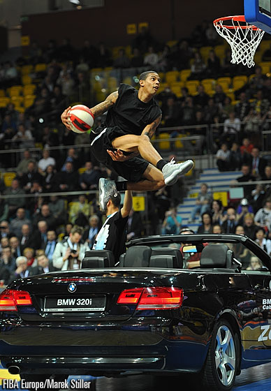 Guy Dupuis dunking over a convertible car
