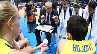 Good Angels head coach Maros Kovacik instructs his playsers during a time-out