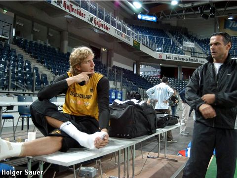 Dirk Nowitzki and Dirk Bauermann discuss tactics before Germany's European Championship qualifier against Ukraine