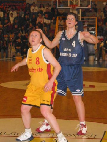 Kristi Harrower (Aix) and Jana Furkova (MBK) keep an eye on the ball.
