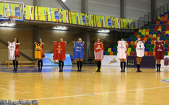 Cheerleaders carrying the national singlets of the eight teams playing the first round of the U18 European Championship 2013 in the Latvian city of Liepaja