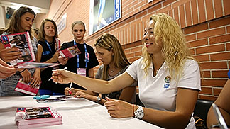 FIBA Europe Women's Basketball Ambassador Ilona Korstin (right) and FIBA Europe Youth Ambassador Natasa Kovacevic signing autographs at the U20 European Championship Women 2014