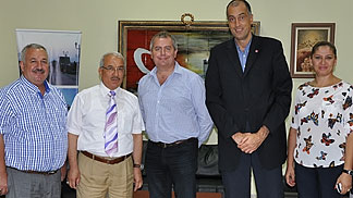 Tarsus Belediyesi Club officials, club president Hikmet Avsar, Emir Turam and the Mayor of Tarsus Burhanettin Kocamaz with Head of Competitions Department Richard Stokes
