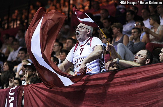 A Latvian fan cheering for his team