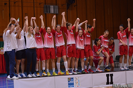 Hungary step onto the podium to receive their silver medals