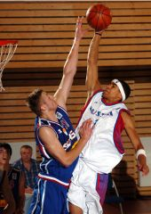 Viktor Keirou (RUS) has this dunk attempt blocked by Zarko Rakocevic (SCG)
