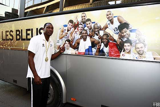 Florent Pieturs poses in front of the France team bus