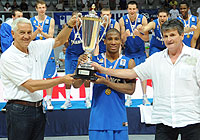 Andrew Albicy receives the winners trophy by FIBA Europe Secretary General Nar Zanolin and Croatian Basketball Federation President Danko Radic