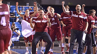 Latvia head coach Arturs Stalbergs and the bench celebrating the win over Spain