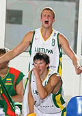 Zygimantas Janavicius and Paulius Kleiza celebrate from the Lithuanian bench.