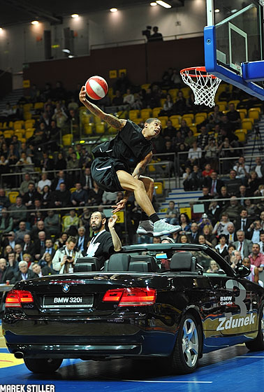 Guy Dupuy dunks over a car