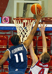 Gary Florimont (France) blocks Russia's Andrey Vorontsevich