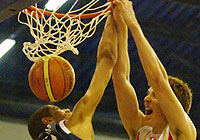 Nicolas Batum (left, France) and Victor Claves (Spain)